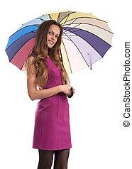Smiling woman holding an umbrella