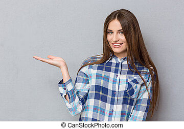 Smiling woman holding copyspace on the palm