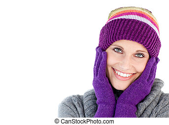 Smiling woman holding her head in her hands