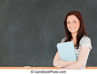 Smiling woman holding her notes