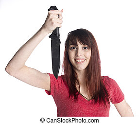 Smiling Woman Holding Knife Looking at Camera