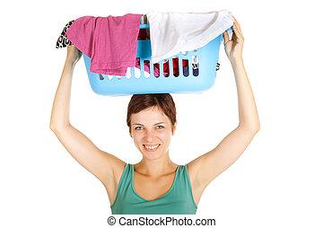 woman holding laundry basket - smiling woman holding laundry...