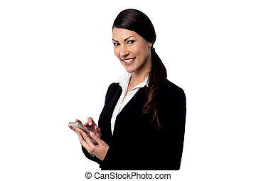 Smiling woman holding mobile phone