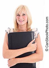 Smiling woman holding outsized portfolio