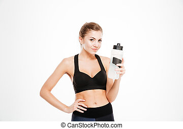 Smiling woman holding shaker with water isolated on a white ...