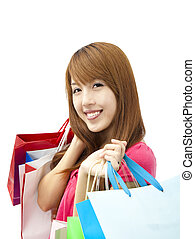 smiling woman holding shopping bag isolated on white