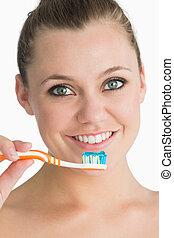 Smiling woman holding toothbrush