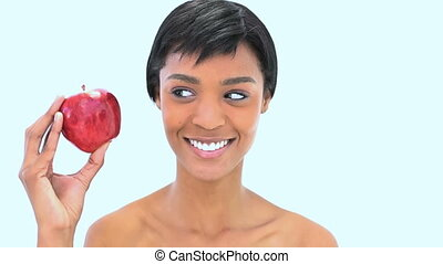 Smiling woman holding two apples