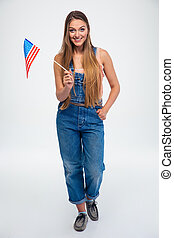 Smiling woman holding USA flag