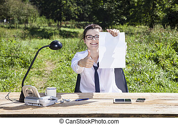 smiling woman holds a business card with space for advertisement