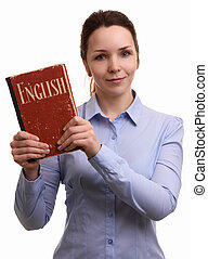 smiling woman holds an english textbook
