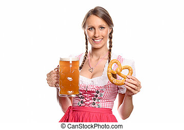 Smiling woman in a dirndl with a beer and pretzel - Smiling...