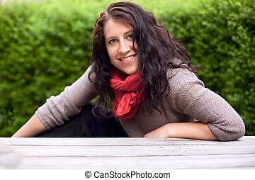 Smiling Woman in a Park Posing for the Camera