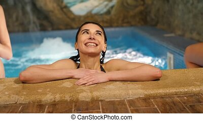 Smiling woman in a pool