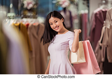 Smiling woman in a store