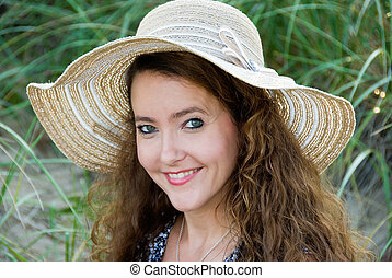 smiling woman in a summer hat