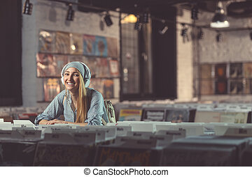 Smiling woman in a vinyl store