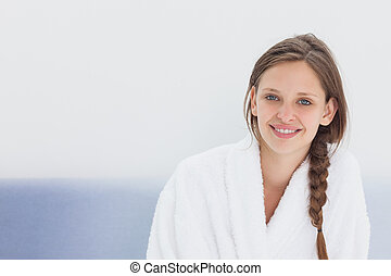 Smiling woman in bathrobe - Smiling young woman in bathrobe...