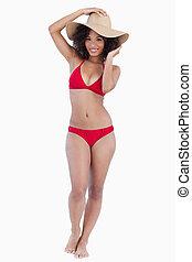 Smiling woman in beachwear looking at the camera