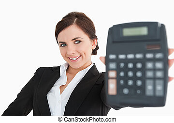 Smiling woman in black suit showing a calculator