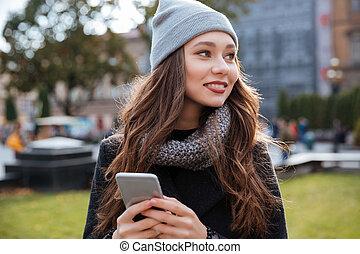 Smiling woman in coat
