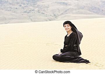 Smiling woman in desert