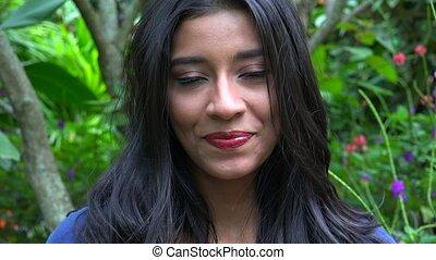 Smiling Woman In Flower Garden
