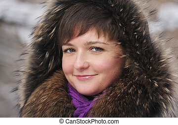 Smiling woman in frosty day