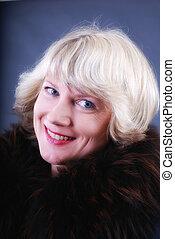 smiling woman in fur