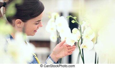 smiling woman in garden of flowers