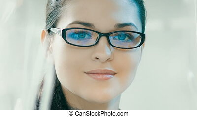 Smiling woman in glasses