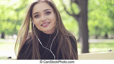 Smiling woman in headphones posing - Portrait of beautiful...