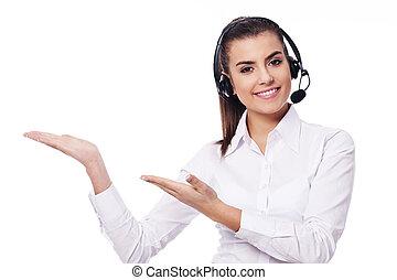 Smiling woman in headset presentation something