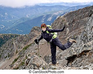 Smiling woman in mountains hiking and loosing weight.