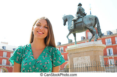Smiling woman in Plaza Mayor square, Madrid, Spain