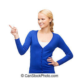 smiling woman in pointing her finger