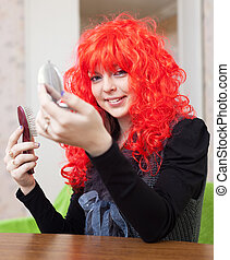 Smiling woman in red periwig