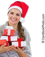 Smiling woman in Santa hat with Christmas gift boxes