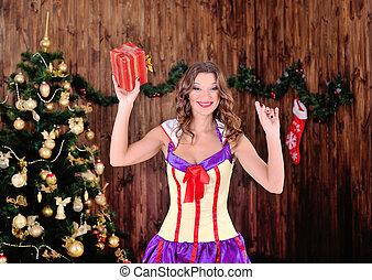 smiling woman in santa helper hat
