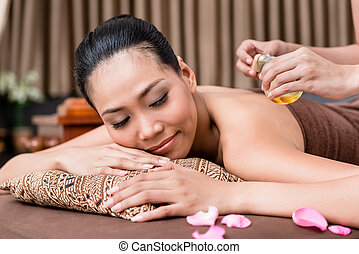 Smiling woman in spa