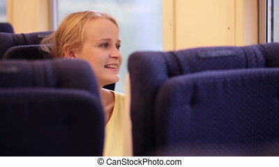Smiling woman in the train.