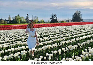 Smiling woman in tulip fields. - Skagit Valley Tulip...
