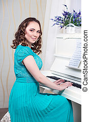 Smiling woman in turquoise dress