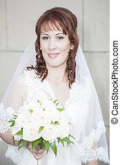Smiling woman in wedding dress