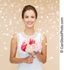 smiling woman in white dress with flowers