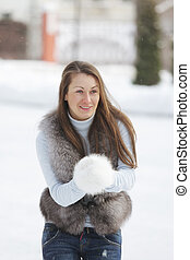 Smiling woman in winter day