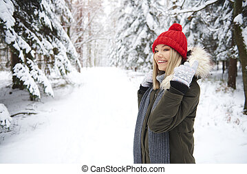 Smiling woman in winter forest