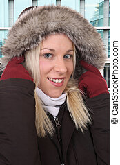 Smiling woman in winter with warm clothing outdoor in town