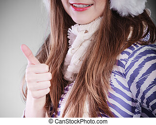 Smiling woman in wintertime.