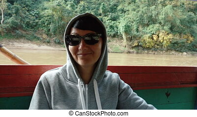 Smiling woman is traveling by boat